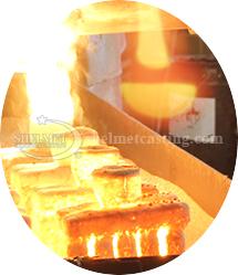 Pouring molten alloy | 902-622-3344